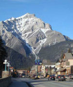 Memorial – View of Banff avenue showing the location of the Royal Canadian Legion building - near the Canadian flag.  The Banff (Alberta) War Memorial is located outdoors on the front wall of this building.