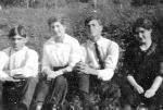 Group photo – Henry Woodroffe and Josephine Thorne, Ira Young, and Letty Woodroffe taken in Barnesdale, Ontario (Foote's Bay) about the summer of 1915.  the inscription identifying Ira is on the back of the photo.