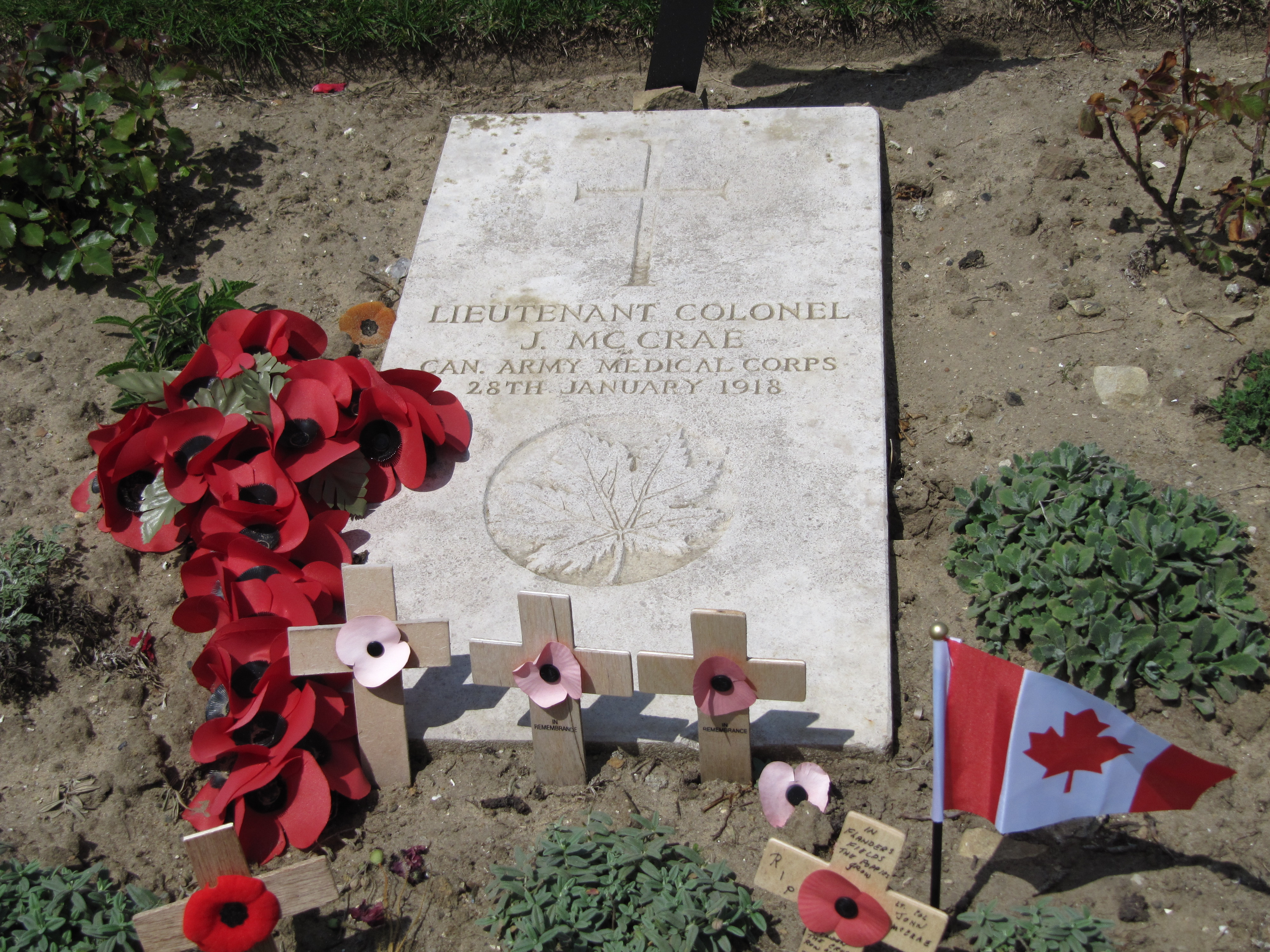 Grave marker – John McCrae's as I found it in June 2011, surrounded by tributes, as it usually is at any time of the year.