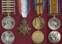 Medals – Left to right: Queen's South Africa Medal with Clasps, 1914-15 Star,  Victory Medal, British War Medal.  The medals shown in this picture are from the Canadian Military Medals and Decorations section of the Veterans Affairs Canada website.