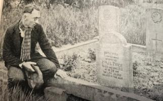 Paying respects – George Price's original grave at Havre Old Communal Cemetery, which was later moved to St Symphorien in 1948.  Photo appeared in the 1938 publication 'The Great War - I Was There' showing the grave of Pte G.L. Price, 28th Canadians, killed at 10:58 am on 11/11/18, Armistice Day. Price was the last Canadian and Commonwealth soldier to die in WW1. The man with hat in hand paying his respects is unknown, but may have been a fellow soldier or a family member.