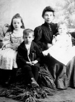 Family Photo – Left to right:  Frances, Charles and Edith Collyerwith mother Jessie (Pearson) Collyer,taken Moosomin, NWT, probably 1895Source: N. Hockin