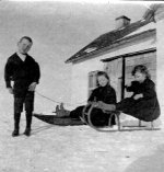 Charles with sisters – Charles toboganning with sisters Frances and Edithat home near Welwyn, NWT (Saskatchewan), winter 1896-97 Source: N. Hockin