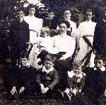 Charles Collyer with his siblings and step-mother – Charles Collyer with his siblings and step-mother at home, London Ontario, 1908.  Left to right. Back row:  Cyril, Edith, Charles, Frances, Ethel and Ralph.  Middle row:  Olive with mother Emily (Lewarton) Collyer.  Front row:  Eric, Percy, Gerald and Ernie Collyer.