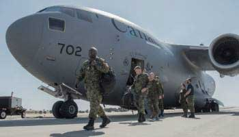 CAF soldiers exiting a C-17 on the tarmac