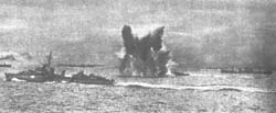 Convoy advances while escorts drop depth charges
