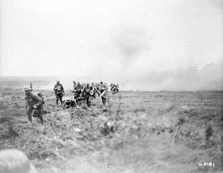 Canadian troops advancing through a German barrage east of Arras. Photo: Library and Archives Canada/PA-003145