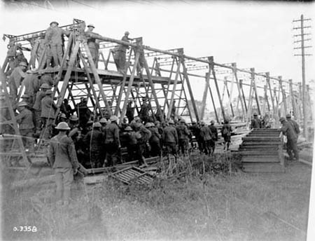 Canadians constructing a bridge across Canal du Nord. Advance east of Arras. September, 1918. Photo: Library and Archives Canada/PA-003456