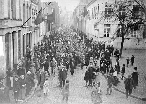 Canadians marching through the streets of Mons on the morning of 11 November 1918. Photo: Library and Archives Canada/PA-003547