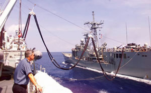 HMCS Protecteur refueling an RN frigate off East Timor in 1999.