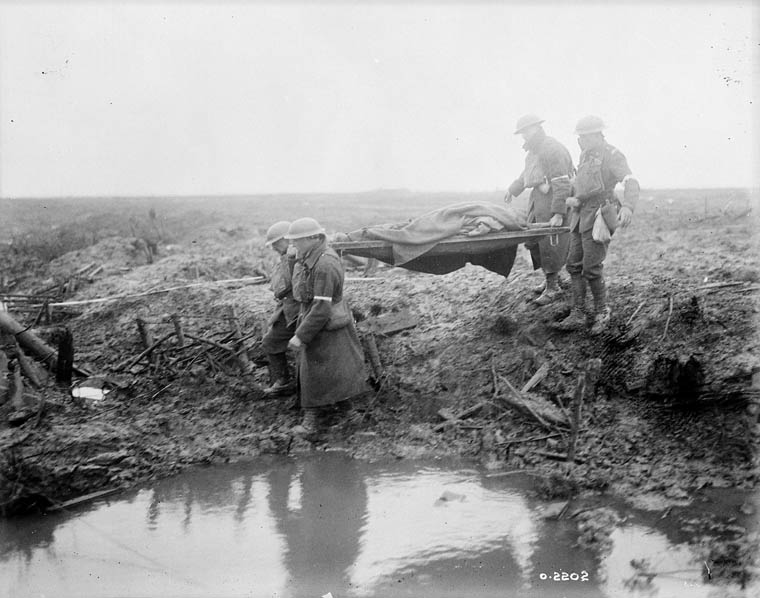 Canadian Pioneers laying trench mats over mud.