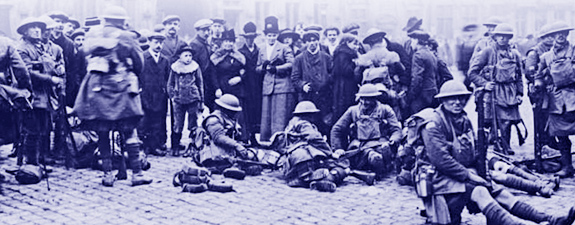 Canadian troops resting in the main square of Mons, Belgium, 11 November 1918.