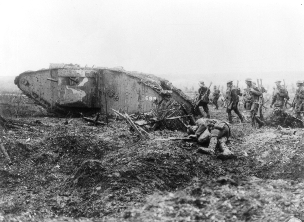 A tank advancing with infantry soldiers during the Battle of Vimy Ridge.
