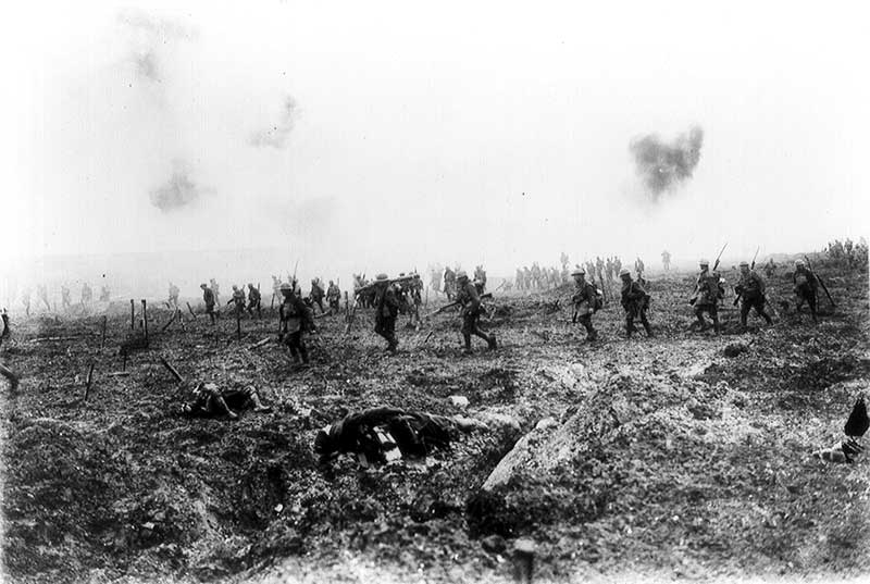 Canadian soldiers advancing through the enemy barbed wire at Vimy Ridge. Photo: Library and Archives Canada PA-001086