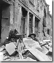 Canadian troops manning Bren gun, Caen, Normandy, July 1944.