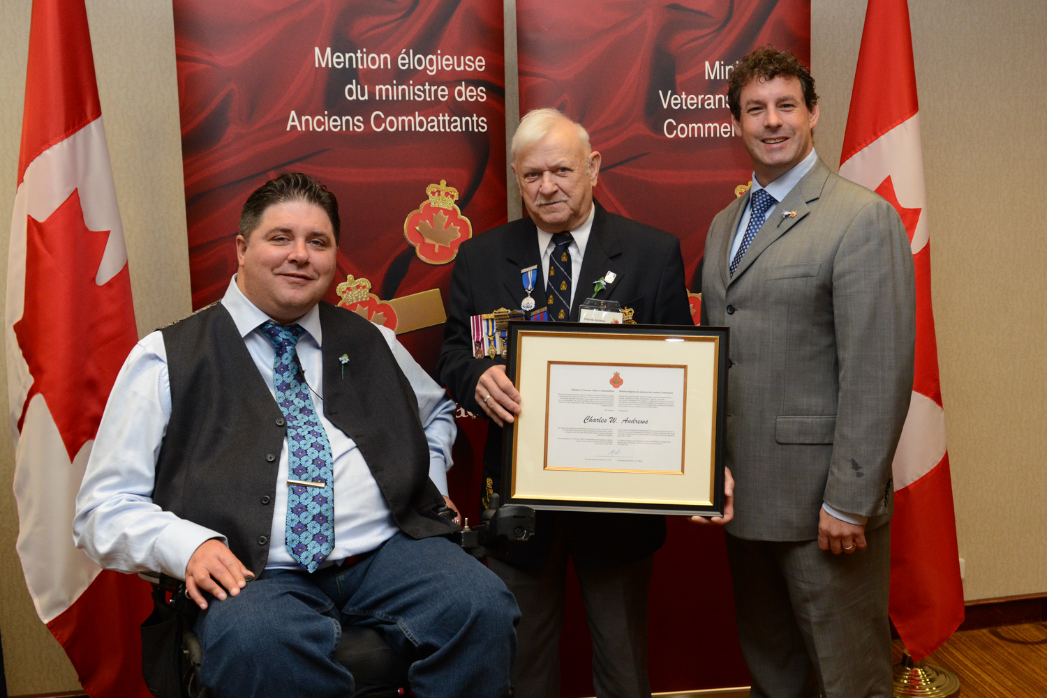 The honorable Kent Hehr, Minister for Veterans Affairs, Mr. Charles Andrews, and Nick Whalen, Member of Parliament for St. John's East.