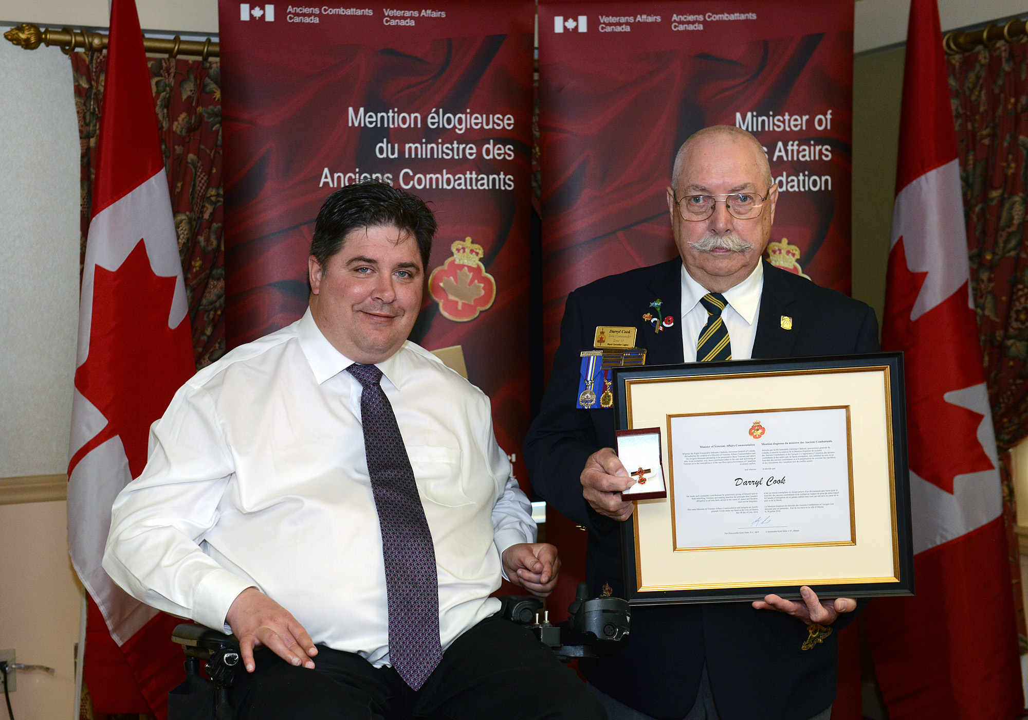 The honorable Kent Hehr, Minister for Veterans Affairs and Mr. Darryl Cook.
