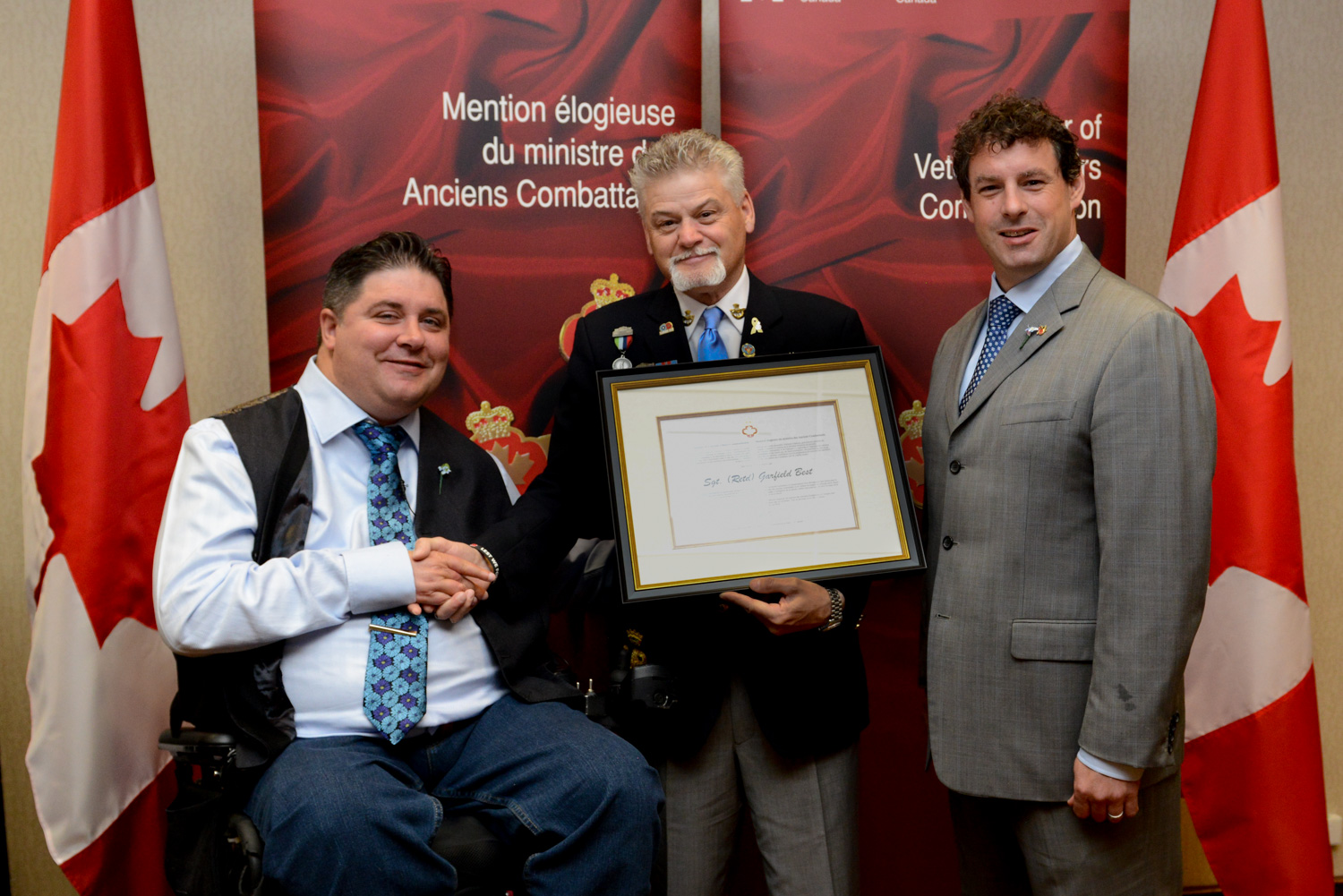 The honorable Kent Hehr, Minister for Veterans Affairs, Mr. Garfield Best, and Nick Whalen, Member of Parliament for St. John's East.
