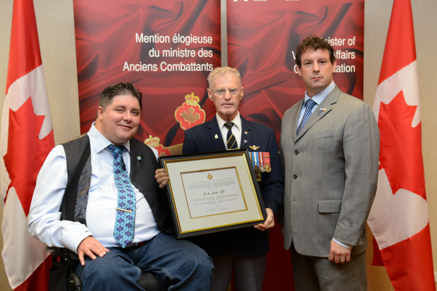 The honorable Kent Hehr, Minister for Veterans Affairs, Mr. George Cake, and Nick Whalen, Member of Parliament for St. John's East.