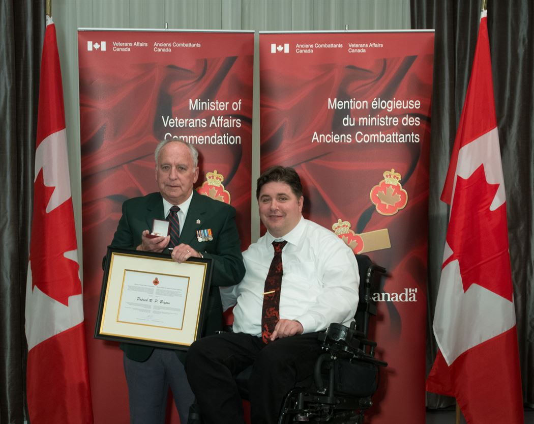 The honorable Kent Hehr, Minister for Veterans Affairs, and Patrick R.P. Bryson