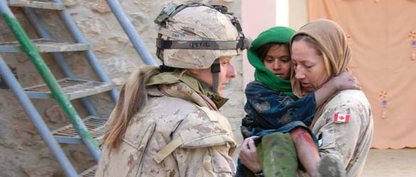 Canadian Armed Forces members help a young Afghan girl suffering from a burn.