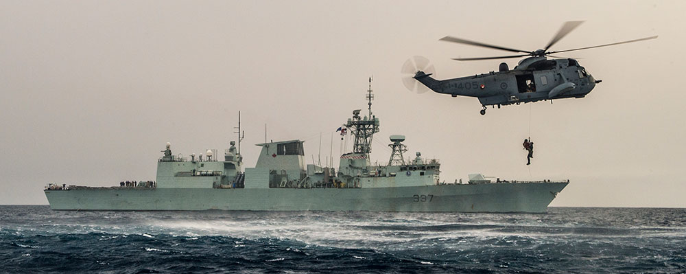 HMCS Fredericton and Canadian helicopter in the Mediterranean Sea in 2016.