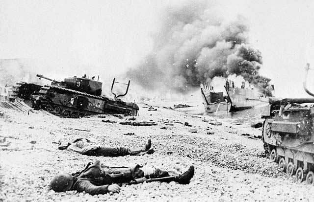 Fallen soldiers amid damaged tanks and landing craft on the beaches of Dieppe.