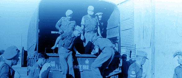 Canadian peacekeepers dismounting from truck during United Nations Emergency Force efforts.