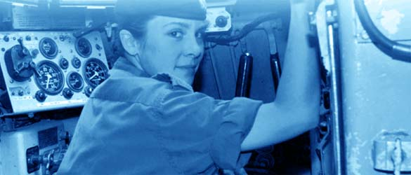 Female Canadian Armed Forces member in the cabin of a military vehicle.