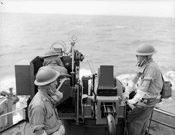 HMCS Iroquois crew members ready at their gun off the coast of Korea