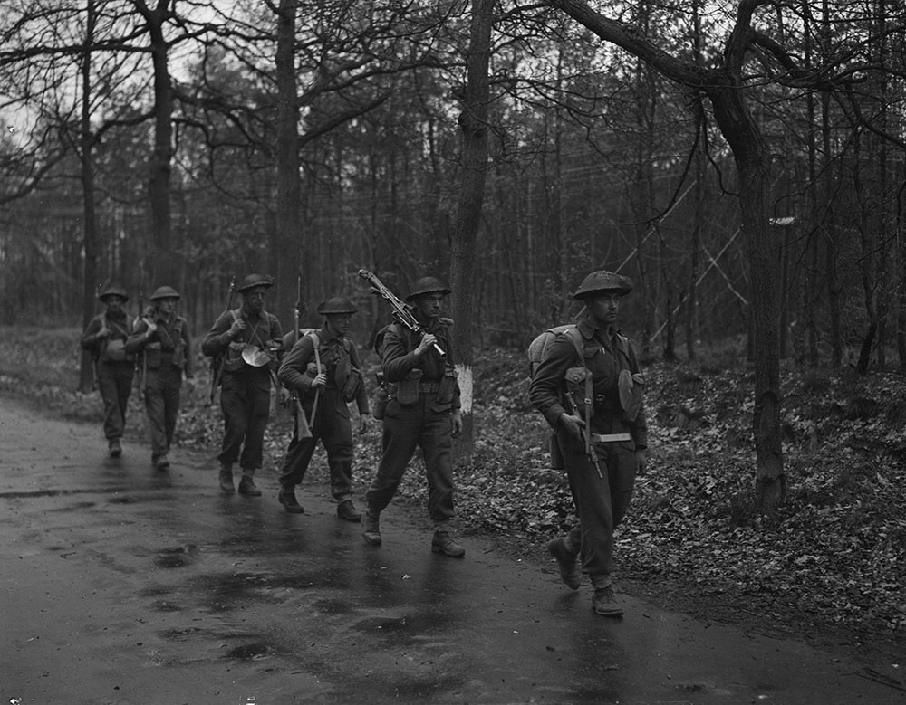 Soldiers of the Perth Regiment on the move near the Dutch city of Arnhem on 15 April 1945.