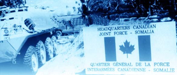 Canadian armoured vehicles in Somalia beside sign for Canadian Headquarters Joint Force.