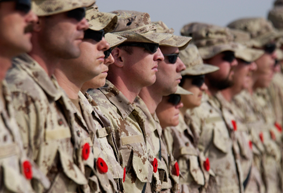 Canadian Forces soldiers on the international mission in Afghanistan as they pause for remembrance