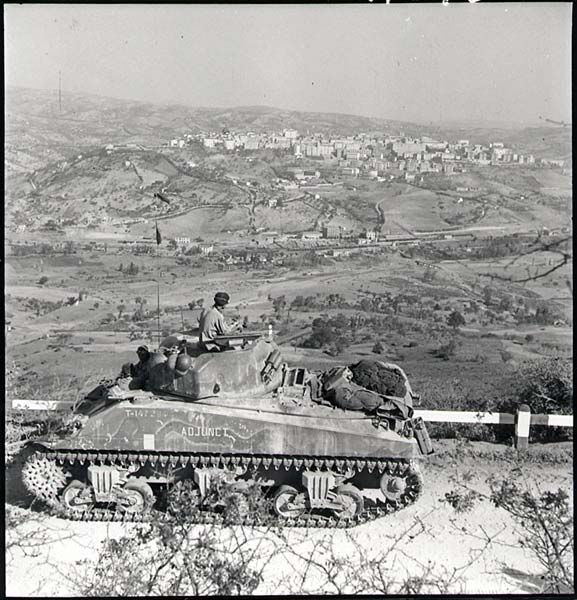 Canadian soldier on tank near Potenza, Italy in September 1943.