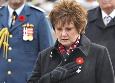 National Memorial (Silver) Cross Mother Roxanne Marie Priede laying a wreath