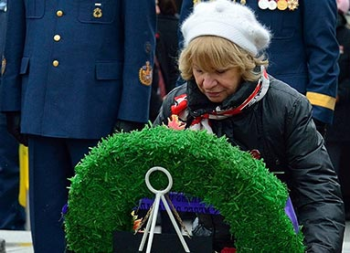 Silver Cross Mother Niki Psiharis laying a wreath