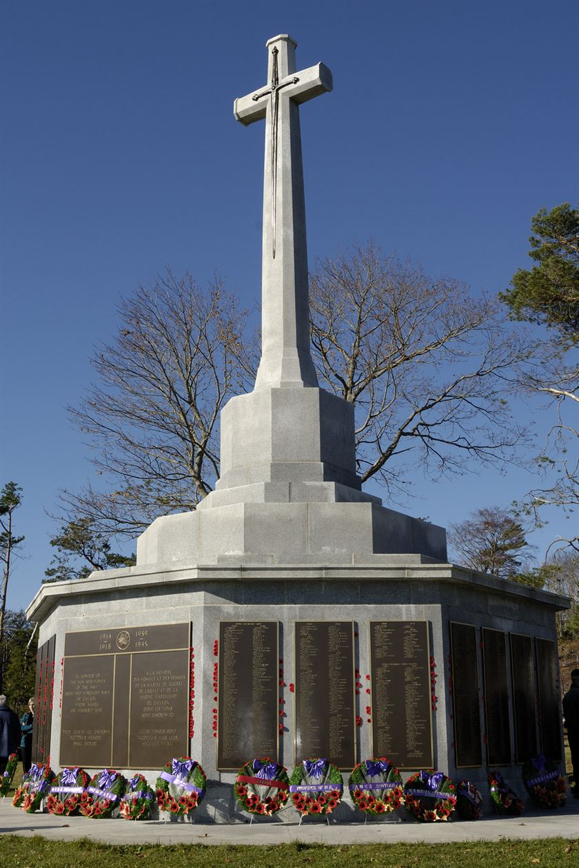 Halifax (Sailors') Memorial Cross of Sacrifice bedecked with poppies after Remembrance Day ceremony.