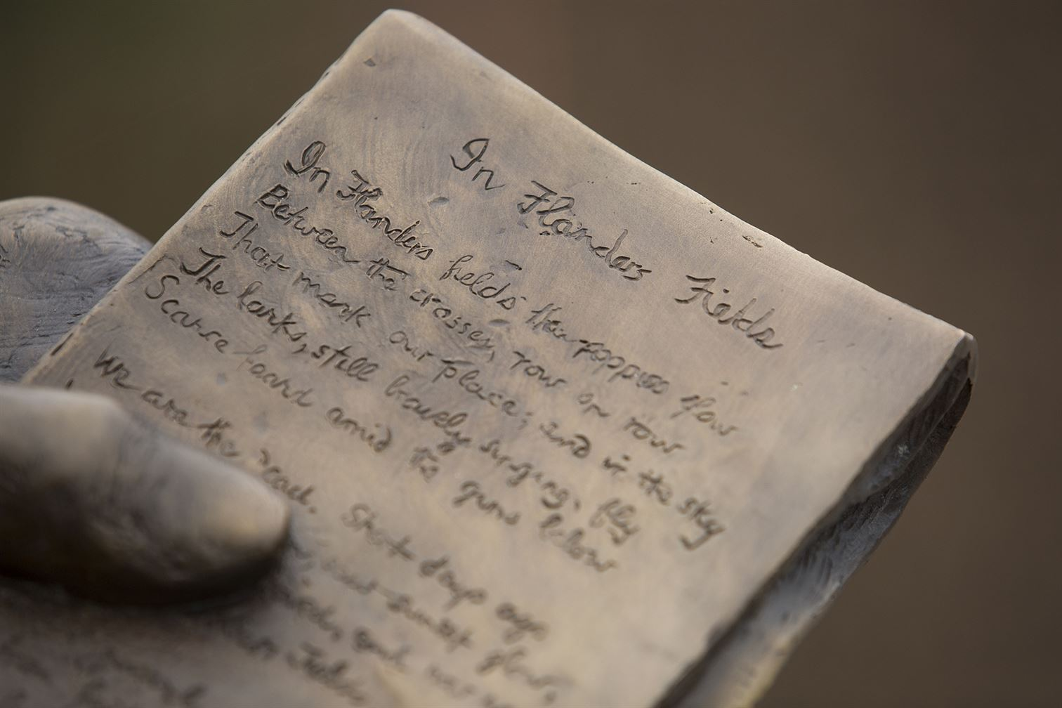 notepad with the poem In Flanders Fields inscribed