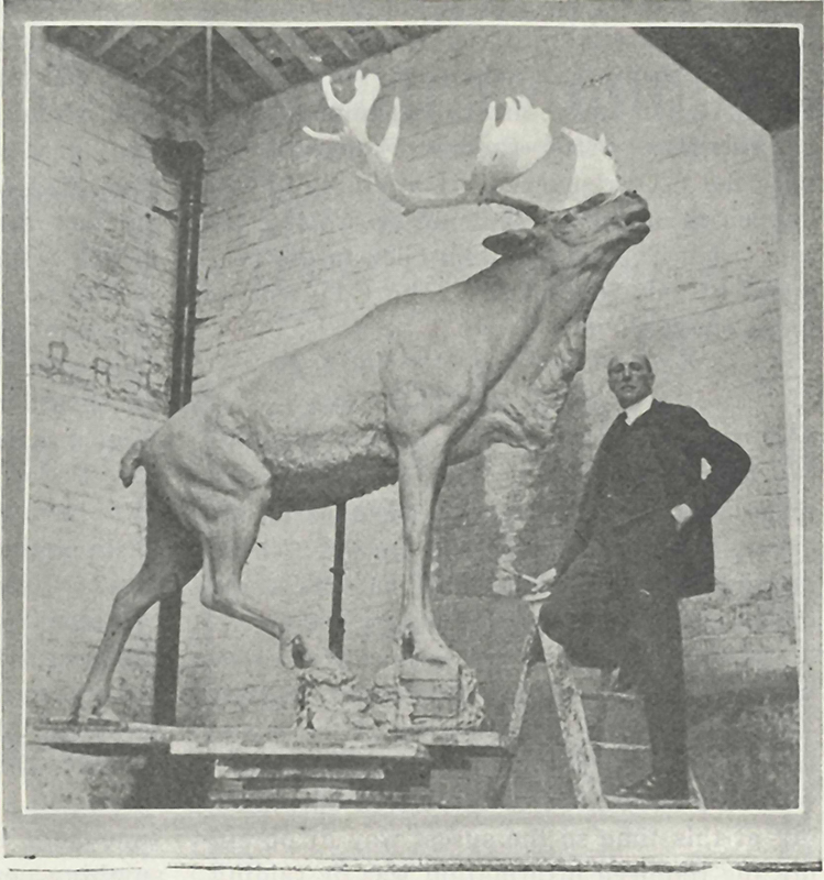 Sculptor Basil Gotto pictured with a model of the Caribou Monument