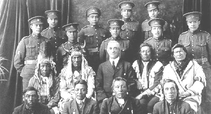 Recruits from the Saskatchewan's File Hills community pose with elders, family members, and representative from the Department of Indian Affairs before departing for Great Britain.